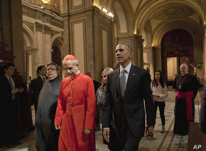 President Barack Obama walks with Cardinal Mario Aurelio Poli as he tours the Buenos Aires Metropolitan Cathedral in Buenos Aires, Argentina, March 23, 2016.