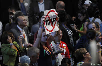 A delegate holds an anti-Trans-Pacific Partnership (TPP) trade agreement sign during the first day of the Democratic National Convention in Philadelphia, July 25, 2016.