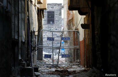 A police barrier blocks a narrow back alley of Sur, an historical district of southeastern province of Diyarbakir, Turkey, March 10, 2017.