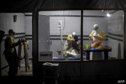 FILE - Health workers treat an unconfirmed Ebola patient, inside a MSF (Doctors Without Borders) supported Ebola Treatment Centre (ETC) in Butembo, Democratic Republic of the Congo, Nov. 3, 2018.