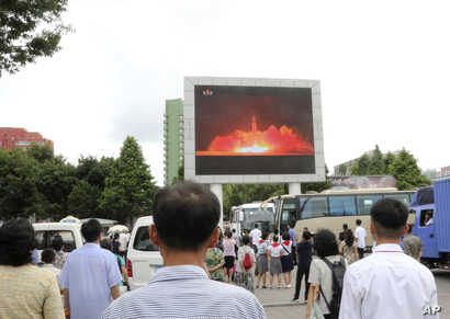 People watch a news broadcast of a missile launch in Pyongyang, North Korea, July 29, 2017. North Korean leader Kim Jong Un said Saturday the second flight test of an intercontinental ballistic missile demonstrated his country can hit the U.S. mainla...