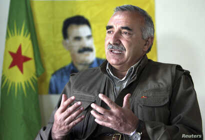FILE - Murat Karayilan, acting military commander of the Kurdistan Workers Party (PKK), speaks with Reuters at the Qandil mountains near the Iraq-Turkish border in Sulaimaniya, 330 km (205 miles) northeast of Baghdad, March 24, 2013.