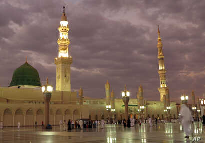 FILE -- In this July 5, 2013 file photo, worshipers visit the Prophet's Mosque in Medina, Saudi Arabia.