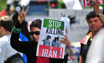 FILE - Women demonstrate against Iran's treatment of homosexuals during a gay pride parade in Berlin, June 19, 2010.