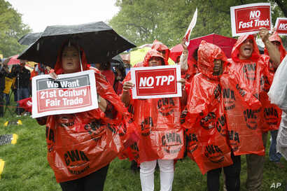 FILE - Demonstrators rally for fair trade at the Capitol in Washington, May 7, 2014