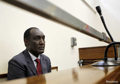 Exiled Rwandan General Faustin Kayumba Nyamwasa looks on during his court appearance in Johannesburg, June 21 2012.