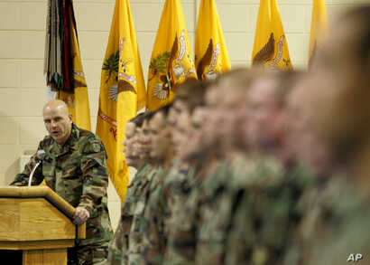 FILE - H.R. McMaster, then a colonel, looks to the soldiers during the Third Armored Cavalry Reenlistment Ceremony at Waller Gym at Fort Carson in Colorado Springs, Colo., Dec. 1, 2004.