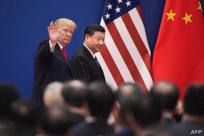 U.S. President Donald Trump and China's President Xi Jinping leave a business leaders event at the Great Hall of the People in Beijing, Nov. 9, 2017.
