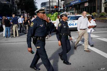 Emergency personnel and police respond to a reported active shooter situation near Fountain Square, Sept. 6, 2018, in downtown Cincinnati, Ohio.
