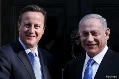 Britain's Prime Minister David Cameron (L) greets Israel's Prime Minister Benjamin Netanyahu as he arrives at Number 10 Downing Street in London, Britain, Sept. 10, 2015.