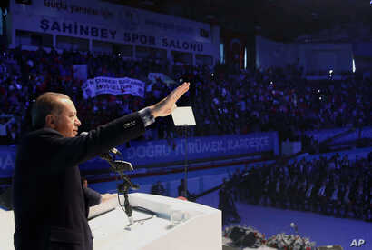 Turkish President Recep Tayyip Erdogan addresses voters in Gaziantep, Turkey, Oct. 24, 2015, in apparent breach of law that calls for his neutrality in elections campaigns..