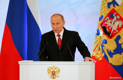 Russian President Vladimir Putin delivers a speech during his annual state of the nation address at the Kremlin in Moscow, Dec. 1, 2016.
