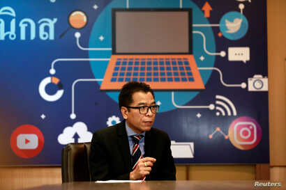 Sawang Boonmee, deputy secretary-general of Election Commission talks as he works in a social media war room in Bangkok, Thailand, March 8, 2019.
