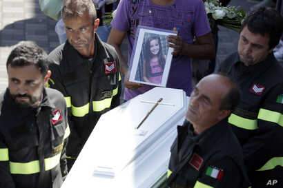 The coffin of Giulia, 9 years old, is carried outside the gymnasium at the end of the state funeral service in Ascoli Piceno, Italy, Aug. 27, 2016. As Italians observed a day of national mourning, President Sergio Mattarella and Premier Matteo Renzi ...