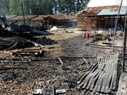 Burned structures are seen after attackers set fire to an Ebola treatment center run by Medecins Sans Frontieres (MSF) in the east Congolese town of Katwa, Democratic Republic of Congo, Feb. 25, 2019. Picture taken February 25, 2019. (Laurie Bonnaud/