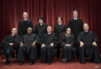 FILE - The justices of the U.S. Supreme Court gather for a formal group portrait at the Supreme Court Building in Washington, Nov. 30, 2018.