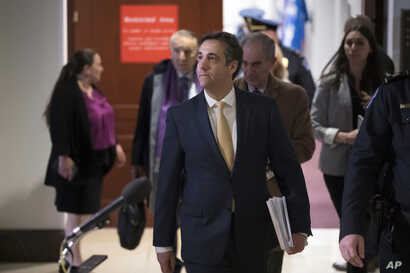 Michael Cohen, President Donald Trump's former lawyer, leaves a closed-door interview before the House Intelligence Committee at the end of three days of congressional testimony, in Washington, Thursday, Feb. 28, 2019.