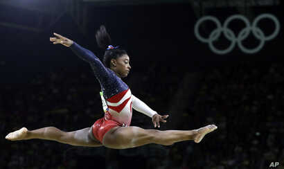 United States' Simone Biles performs on the balance beam during the artistic gymnastics women's team final at the 2016 Summer Olympics in Rio de Janeiro, Brazil, Aug. 9, 2016.