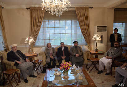 Members of Afghanistan's High Peace Council talks with delegates (not pictured) from the Hezb-e-Islami group, during a meeting in Kabul, March 17, 2016.