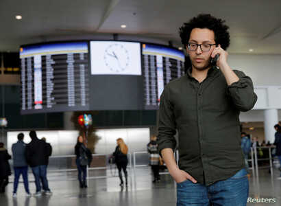 Mark Doss, Supervising Attorney for the International Refugee Assistance Project at the Urban Justice Center speaks on his cell phone at John F. Kennedy International Airport in Queens, New York, Jan. 28, 2017.