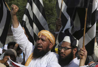 Supporters of Jamiat-e-Ulema Islam, a Pakistani religious group protest a suicide bombing on May 14, 2017. The Islamic State group says it orchestrated a suicide attack on Abdul Ghafoor Haideri, a Pakistani lawmaker. The attack killed 25 people but o...