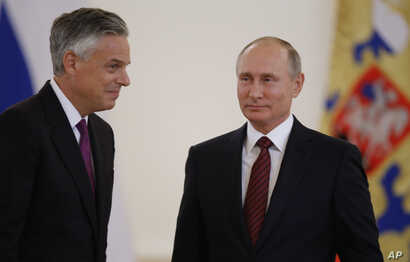 U.S. Ambassador Jon Huntsman, left, is pictured after presenting credentials to Russian President Vladimir Putin during a ceremony in the Kremlin in Moscow, Oct. 3, 2017.