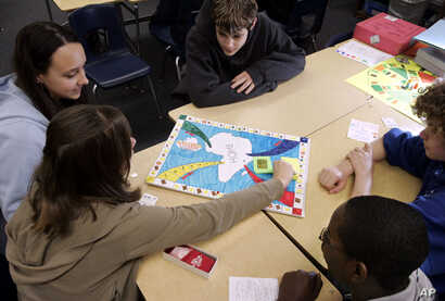 FILE — Eighth-grade social studies students at Mount Hebron School in Montclair, New Jersey, play a game they devised based on the story of the revolt on the slave ship Amistad.