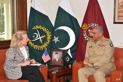 Alice Wells, U.S. deputy assistant secretary of state, meets with Pakistani army chief Gen. Qamar Javed Bajwa to discuss how to ensure peace in Afghanistan following a recent cease-fire between the Taliban and Kabul, in Rawalpindi, Pakistan, July 3, ...