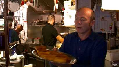Restaurant owner Stephane Dantier says the neighborhood has had a hard time moving on. (L. Bryant/VOA)