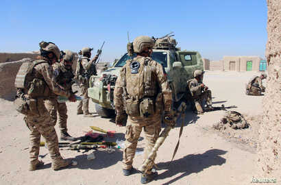 Afghan Special Forces prepare themselves for battle with the Taliban on the outskirts of Lashkar Gah capital of Helmand, Afghanistan, Oct. 10, 2016.