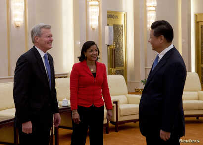 From left, U.S. Ambassador to China Max Baucus and U.S. National Security Adviser Susan Rice meet with Chinese President Xi Jinping in the Great Hall of the People in Beijing Sept. 9, 2014.