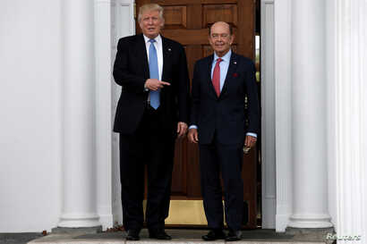 U.S. President-elect Donald Trump stands with Wilbur Ross after their meeting at Trump National Golf Club in Bedminster, New Jersey, U.S., Nov. 20, 2016.