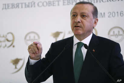 Turkish President Recep Tayyip Erdogan speaks during a meeting on Islam in Eurasia in Istanbul, Oct. 11, 2016. Erdogan says his country is determined to take part in a possible operation to recapture the Iraqi city of Mosul despite objections from Ba