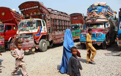 FILE - Afghan refugees living in Pakistan arrive at the UNHCR's Repatriation Center en route to Afghanistan, in Peshawar, Pakistan.