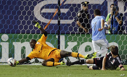 "FILE -- D.C. United goalkeeper Bilal ""Bill"" Hamid, left, stops a shot on the goal."