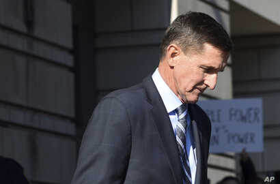 FILE - Former Trump national security adviser Michael Flynn leaves federal court in Washington, Dec. 1, 2017.