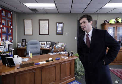 FILE - Mayor Pete Buttigieg talks with an AP reporter at his office in South Bend, Ind., Thursday, Jan. 10, 2019.