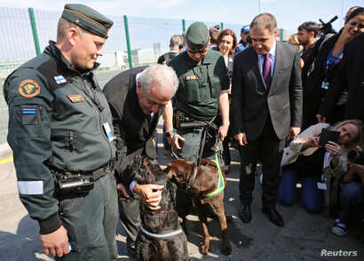 EU Commissioner of Migration Dimitris Avramopoulos poses for a picture with border police from Finland during the official launch of the European Union's Border and Coast Guard Agency at a border crossing on the Bulgarian-Turkish border in Kapitan An...