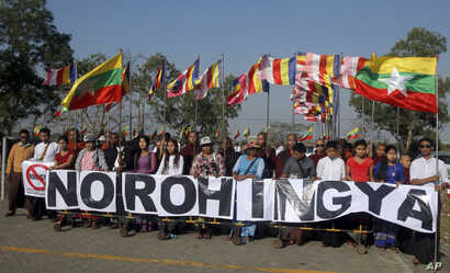 Myanmar protesters hold banners outside Thilawa port where a Malaysian ship full of aid for the Muslim Rohingya minority arrived, in Yangon, Myanmar, Feb. 9, 2017. The protesters deny that the ethnic group Rohingya even exists.