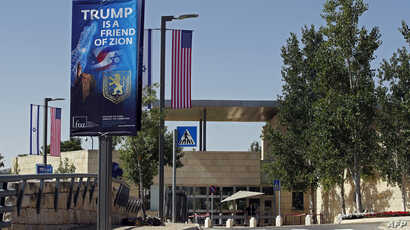 A picture shows on May 11, 2018, the compound of the U.S. consulate in Jerusalem, which will host the new U.S. embassy, as posters praising the U.S. president hang in the street.