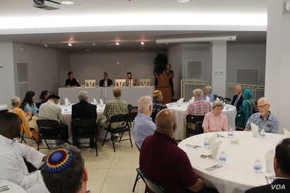 Joan Liversidge, a faith leader from the Quaker Friends House, shares the meaning of fasting during an iftar dinner at the Bait-ur-Rehman Mosque in Silver Spring, Maryland. (Courtesy - Bait-ur-Rehman Mosque)