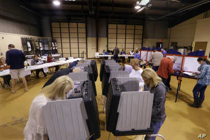 Voters fill out their general election ballots at a polling place in Bradfordton, Illinois, Nov. 8, 2016.