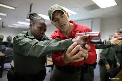 A border patrol trainees take part in pistol training at the United States Border Patrol Academy in Artesia, New Mexico, U.S., June 9, 2017.