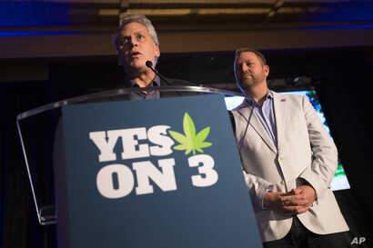 Jimmy Gould, co-founder of Responsible Ohio, a pro-marijuana legalization group, speaks to the crowd after a concession speech delivered by executive director Ian James, right, at an election night event at the Le Meridien hotel, Tuesday, Nov. 3, 201...