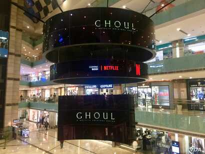 "With original shows like the horror show ""Ghoul"" streaming on Netflix, the entertainment giants hopes to woo Indian viewers. The advertisement is seen in a swanky mall in Gurgaon near Delhi."