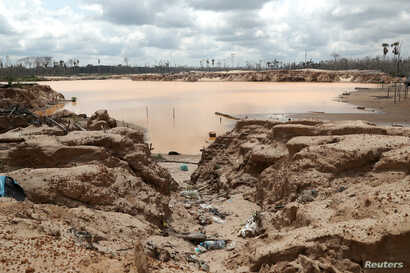 An illegal gold mining camp is seen during a Peruvian military operation to destroy illegal machinery and equipment used by wildcat miners in Madre de Dios, Peru, March 5, 2019.