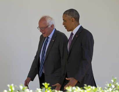 President Barack Obama walks with Democratic presidential candidate Sen. Bernie Sanders, I-Vt., down the Colonnade of the White House in Washington, June 9, 2016.