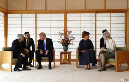 US President Donald Trump (3rd R) talks with Japan's Emperor Akihito (L) while his wife Melania (3rd R) talks with Empress Michiko (R) at the Imperial Palace in Tokyo on November 6, 2017.