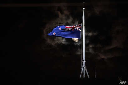 The New Zealand national flag is flown at half-mast on a Parliament building in Wellington on March 15, 2019, after attacks on two Christchurch mosques left at least 49 dead on March 15, with one gunman -- identified as an Australian extremist -- app