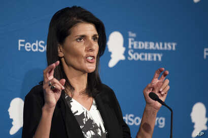 FILE - South Carolina Gov. Nikki Haley gestures while speaking at the Federalist Society's National Lawyers Convention, Nov. 18, 2016, in Washington.